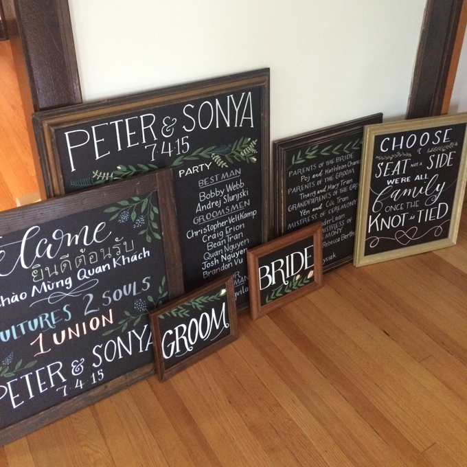 group of chalkboard wedding signs